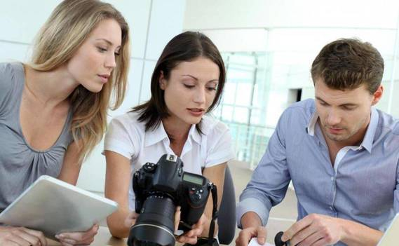 Normal_man-and-women-with-cameras-and-tablet-looking-at-documents