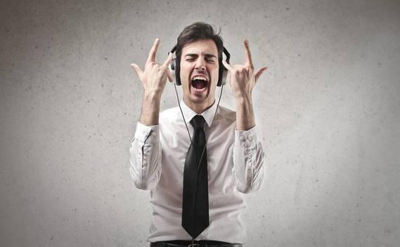Normal_bigstock-young-businessman-listening-mu-46806136