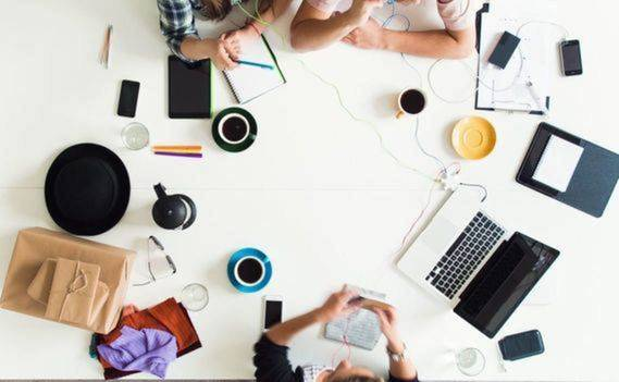 Normal_normal_stock-footage-mixed-race-group-of-people-aerial-view-timelapse-hipster-office-small-business-start-up-company1